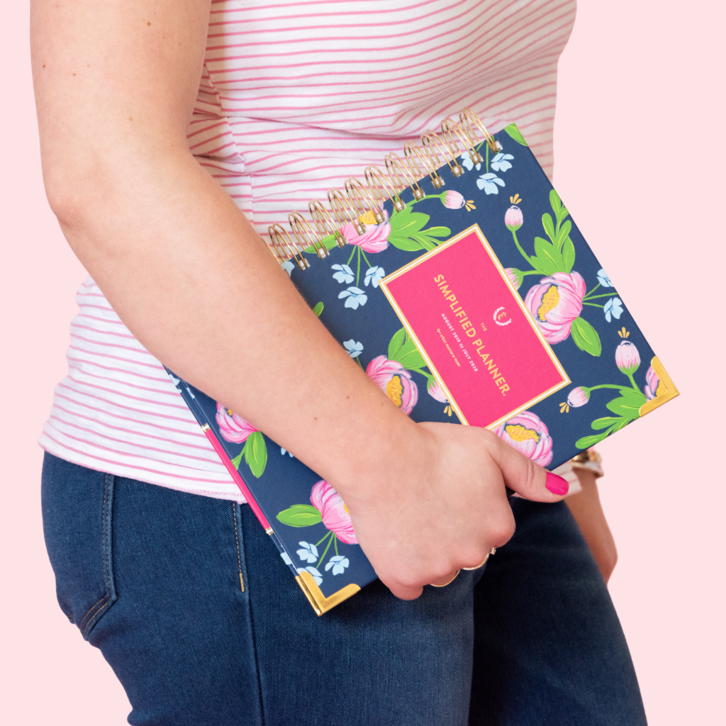 Alexandra of The Productivity Zone carrying a Navy Blooms Daily Simplified Planner