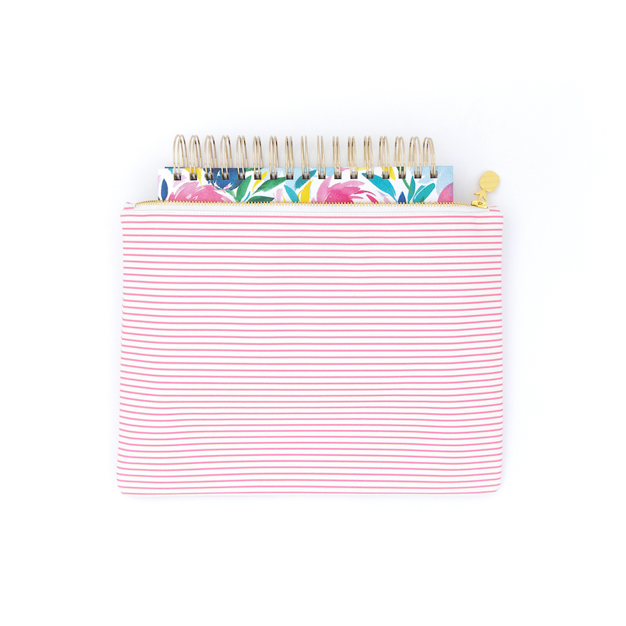 Happy Floral Daily Planner peeking out of a Pink Pinstripe Planner Pouch (coil side up)