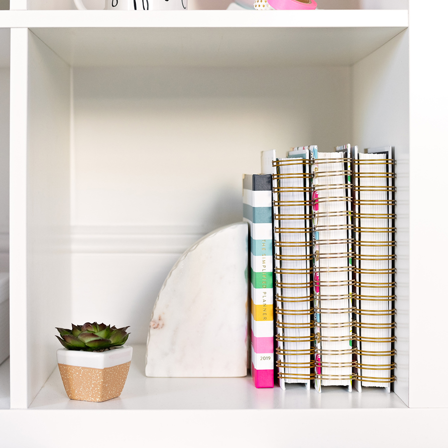Simplified Planners on a styled bookshelf