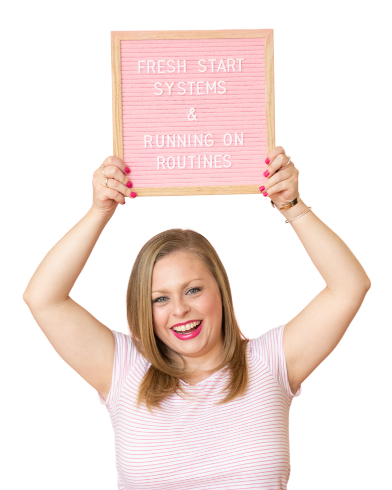 Alexandra of The Productivity Zone holding a pink letterboard with the words Fresh Start Systems & Running on Routines spelled out on it.