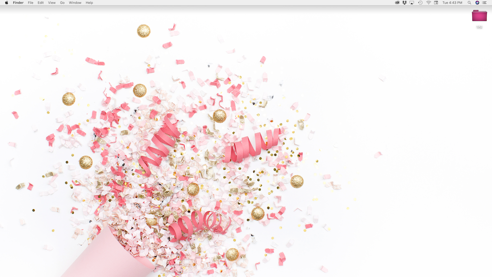 Screenshot of a clean and organized desktop featuring a pink and gold confetti popper as the background.